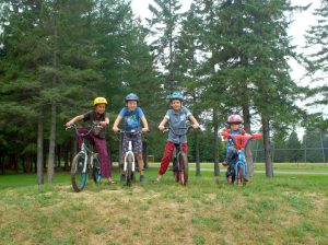 kids posing on their bikes